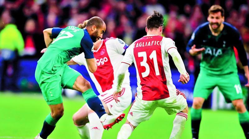 Lucas Moura (left) scores his side's third goal. (Photo: AP)