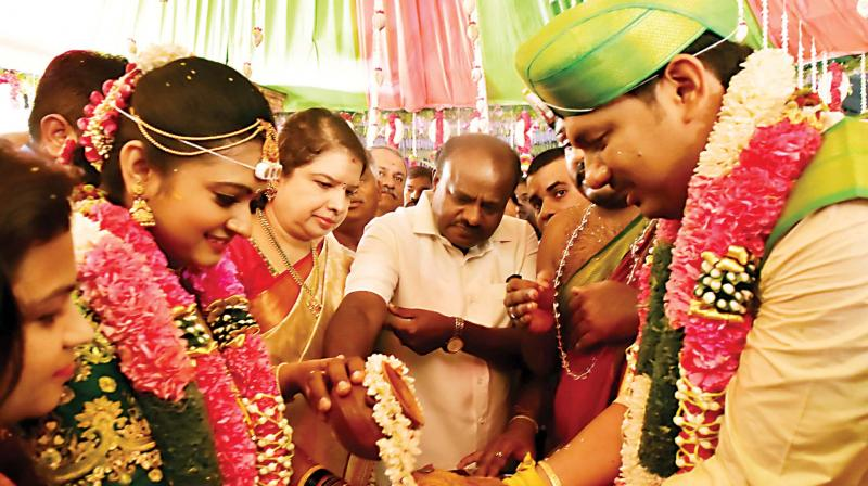 Chief Minister H.D. Kumaraswamy and his wife Anitha Kumaraswamy at the wedding of special officer at CM's office Raghu Kumar in Bengaluru on Thursday (Photo: KPN)