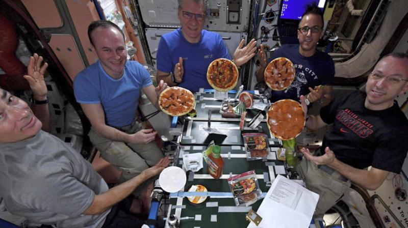 The first-ever pizza party in space is getting sky-high reviews. Photo: AP