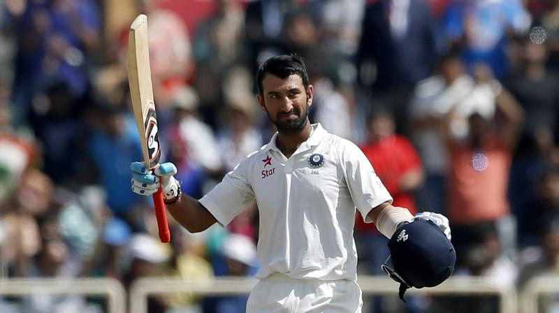 Cheteshwar Pujara brought up his 11th Test ton and led India's charge after Australia scored 451 runs batting first. (Photo: AP)