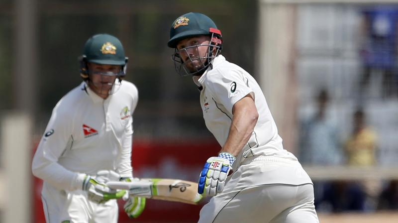 Australia, who began their second innings 152 runs adrift of the hosts, were in deep trouble after being reduced to 63-4 in Ranchi before Peter Handscomb (72 not out) and Shaun Marsh (53) put on 124 for the fifth wicket. (Photo: AP)