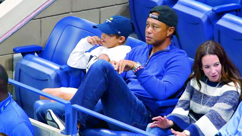 Tiger Woods attends the fourth round match between Nadal and Cilic. (Photo: AFP)