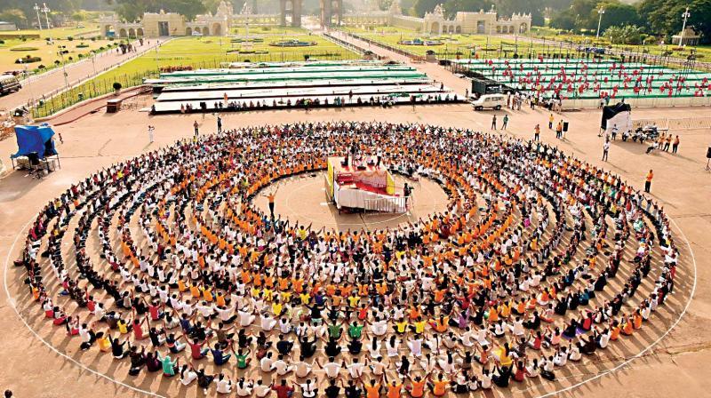 As part of Dasara Yoga, people form  a Yoga Chain at Mysuru Palace on Friday. (Photo: KPN)