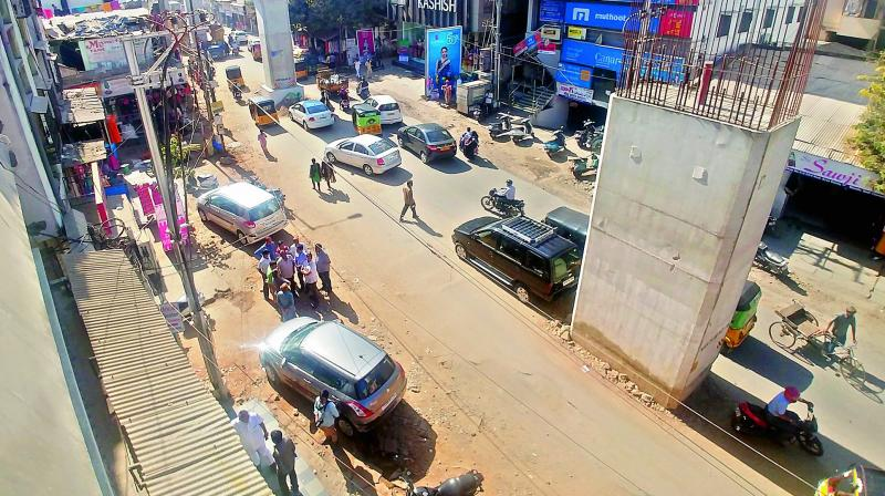 The road at Badi Chowdi in Kachiguda has been dug up to lay water and drainage pipes. Dust from the road has been causing inconvenience to  shopkeepers in the area. —DC