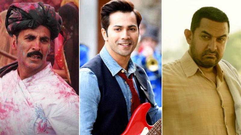 Akshay Kumar in 'Toilet: Ek Prem Katha', Varun Dhawan in 'Judwaa 2' and Aamir Khan in 'Dangal'.