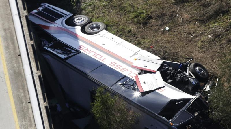 The cause of the crash wasn't immediately known, but survivors from Channelview High School in metro Houston described being asleep one moment and tumbling through the air the next. (Photo: AP)