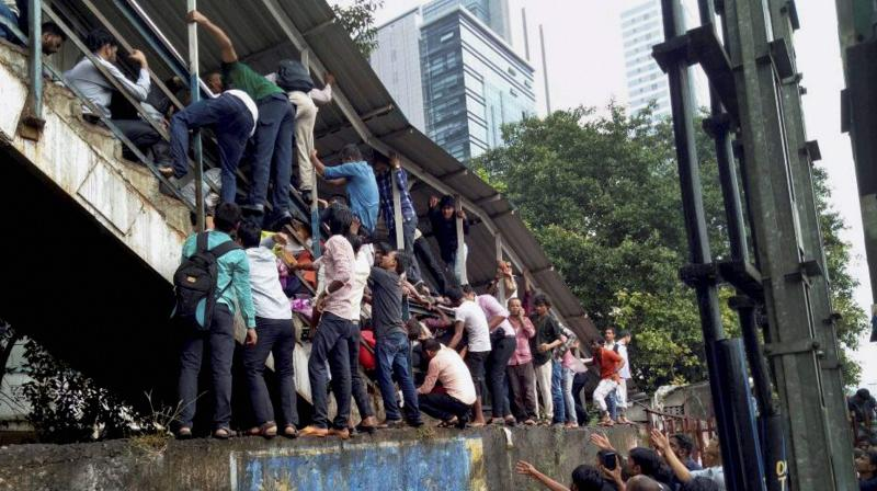 A rumour about the overbridge 'collapsing' sparked panic among morning peak-hour commuters on a rainy day, leading to people rushing towards its staircase with several of them slipping on the wet steps and falling over one another. (Photo: PTI | File)