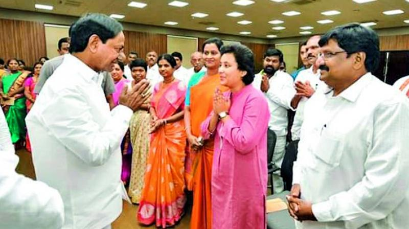 Chief Minister K. Chandrasekhar Rao speaks with newly-elected zilla parishad chairpersons at Pragathi Bhavan, Hyderabad, on Tuesday.