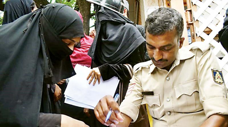A victim filing a complaint with the police at the IMA office in Shivajinagar on Tuesday (Photo: DC)