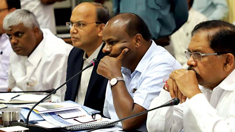 Chief Minister H.D. Kumaraswamy,  Deputy CM G. Parameshwar, Chief Secretary T.M. Vijaya Bhaskar and Public Works minister H.D. Revanna at a meeting of the Public Works Department in Bengaluru on Tuesday (Photo: KPN)