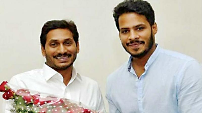 Nikhil Kumaraswamy, JD(S) leader and son of Chief Minister H.D. Kumaraswamy with Andhra Pradesh CM Y.S. Jagan Mohan Reddy in Amaravati on Tuesday (Photo: DC)
