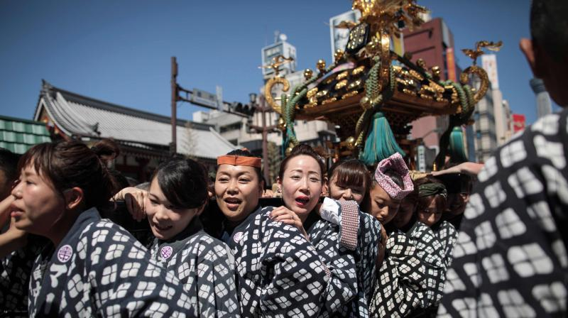 Sanja Matsuri festival is a celebration for the three founders of Sensoji Temple in the Asakusa neighbourhood with nearly two million people visiting during the three-day event. (Photo: AFP)