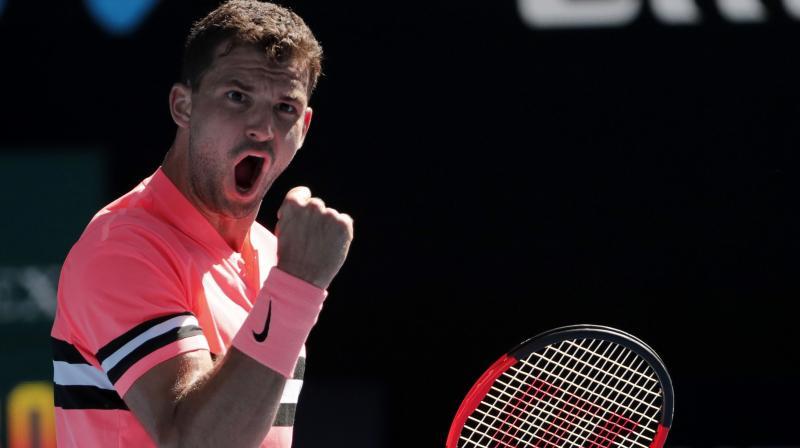 Dimitrov cruises past Novak in Melbourne