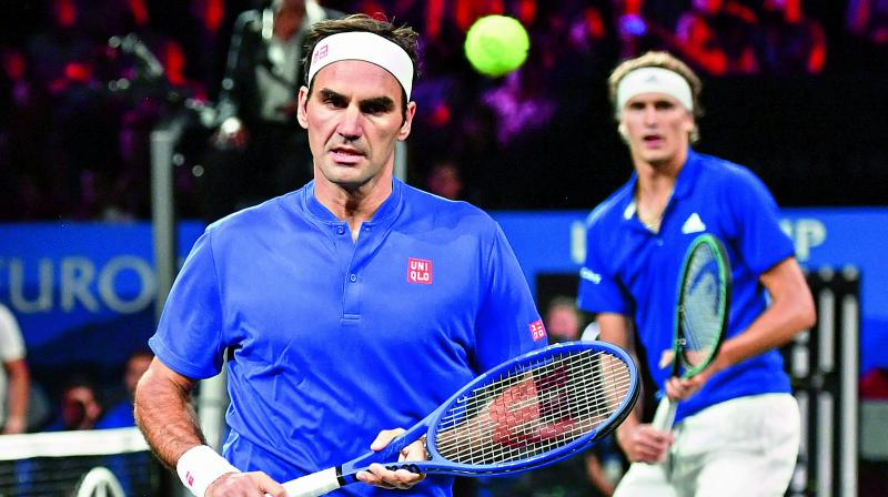 Team Europe's Roger Federer (left) and Alexander Zverev in action during their doubles match against Team World's Denis Shapovalov and Jack Sock as part of the Laver Cup tennis tournament in Geneva, Switzerland. (Photo: AFP)