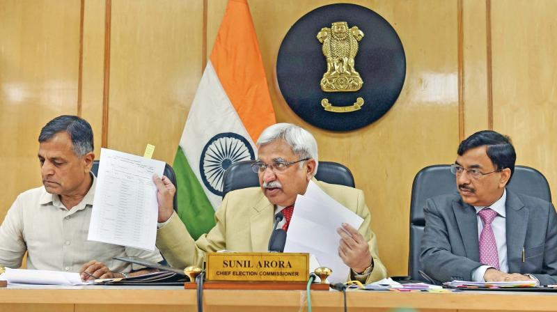 Chief Election Commissioner Sunil Arora flanked by Election Commissioners Ashok Lavasa (left) and Sunil Chandra at the press conference at Election Commission in New Delhi, on Saturday. (Photo: PTI)