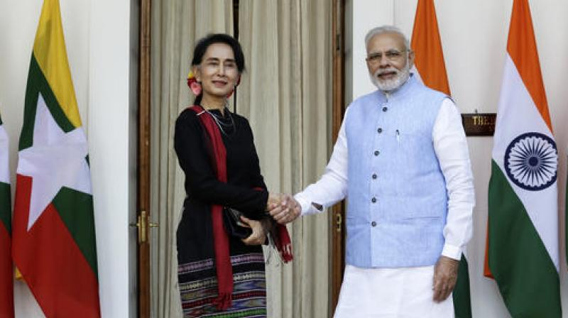 Prime Minister Narendra Modi, right, shakes hand with Myanmar's Foreign Minister Aung San Suu Kyi before a bilateral meeting in New Delhi. (Photo: AP)