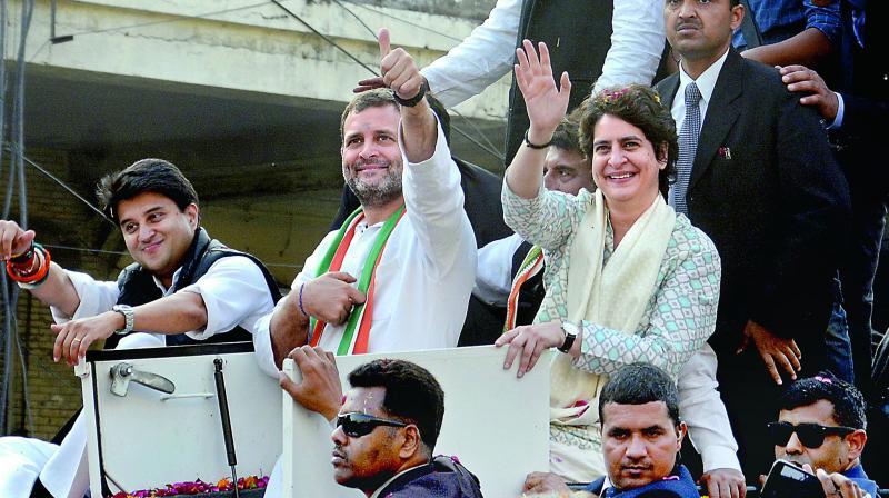 Congress president Rahul Gandhi with party general secretaries Priyanka Gandhi Vadra and Jyotiraditya Scindia during a roadshow in Lucknow on Monday.  (PTI)