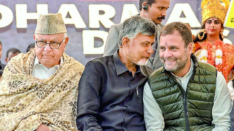 Congress president Rahul Gandhi, National Conference president Farooq Abdullah and Andhra Pradesh Chief Minister Chandrababu Naidu during Dharma Porata Deeksha, in New Delhi on Monday.  (PTI)