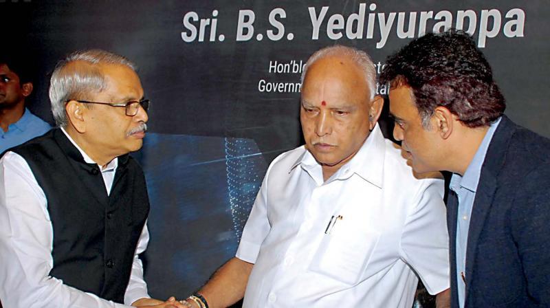CM B.S. Yediyurappa with DyCM  Ashwathnarayana and Chairman of Axilor Ventures Kris Gopalakrishnan at a  meeting in Bengaluru on Thursday (Photo: DC)
