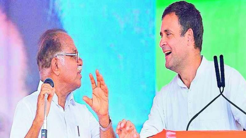 What are you saying?: Rahul Gandhi seems to tell P. J. Kurien who was translating the former's speech at a recent election rally.