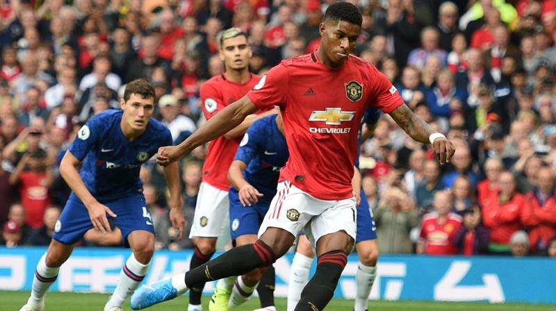 Marcus Rashford struck twice as Manchester United opened their Premier League account with a resounding 4-0 victory over Frank Lampard's Chelsea at Old Trafford on Sunday. (Photo:AFP)