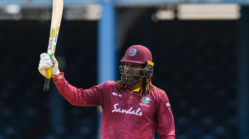 In the second ODI Chris Gayle scripted history by becoming the all time highest run-scorer in the ODIs by adding seven runs to take his tally to 10,353 ODI runs. (Photo:AFP)