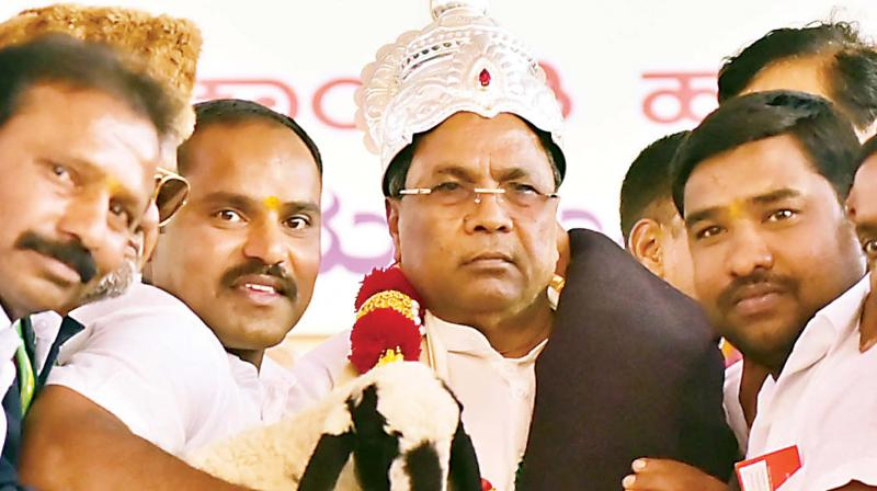 Chief Minister Siddaramaiah being presented with a crown, goat and a blanket at Kadur on Friday  	– KPN