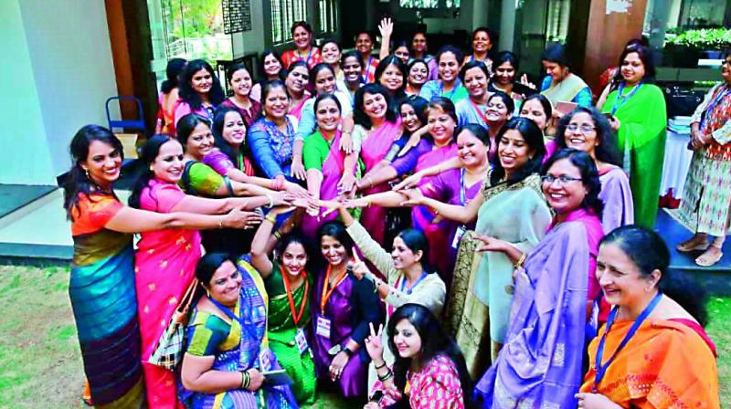 A file photo of Karnataka former chief secretary Ratna Prabha (in centre) with a group of women.