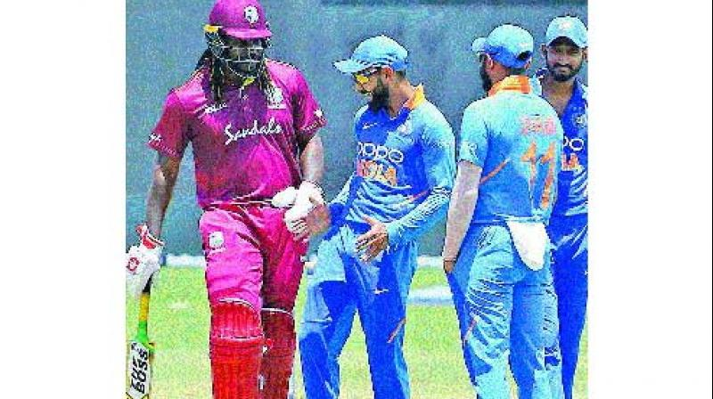 Virat Kohli shakes a leg with Chris Gayle during first ODI which was abandoned due to rain. (Photo: BCCI)