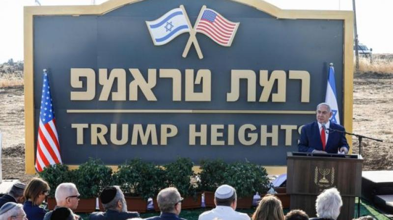 Netanyahu unveiled a 'Trump Heights' sign, featuring an Israeli and a US flag, to mark the site of the new settlement. (Photo: AFP)