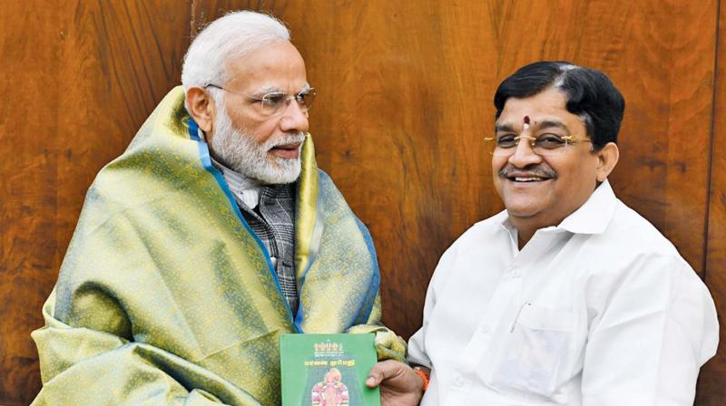 AIADMK Rajya Sabha member Dr V. Maitreyan called on Prime Minister Narendra Modi at New Delhi on Wednesday and presented a copy of his book on Sri Aandal Natchiyar's Thiruppavai. (Photo: DC)