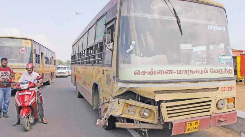 The MTC bus and the call taxi (top) that collided head-on on Kamaraj Salai  on Friday. (Photo: DC)