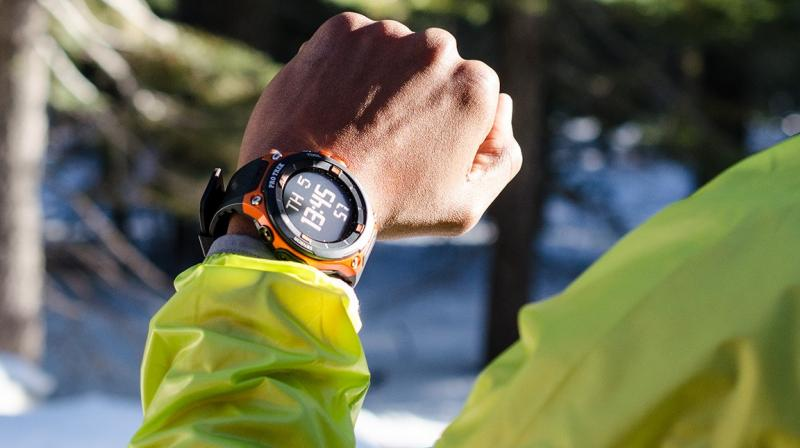 The smartwatch borrows most of its design from its predecessor. It features the same black and orange color scheme, or just pure black, tinted with screws at the top and bottom of the display.