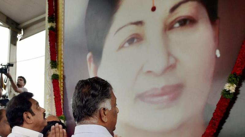 Tamil Nadu Chief Minister K Palanisamy and his deptuy, O Panneerselvam, pay tributes at the memorial of J Jayalalithaa following a merger of their factions in Chennai on Monday. (Photo: PTI)