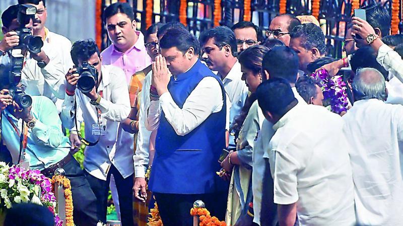 Former Maharashtra CM Devendra Fadnavis pays tribute to Shiv Sena founder Balasaheb Thackeray on his death anniversary, in Mumbai on Sunday.  (PTI)