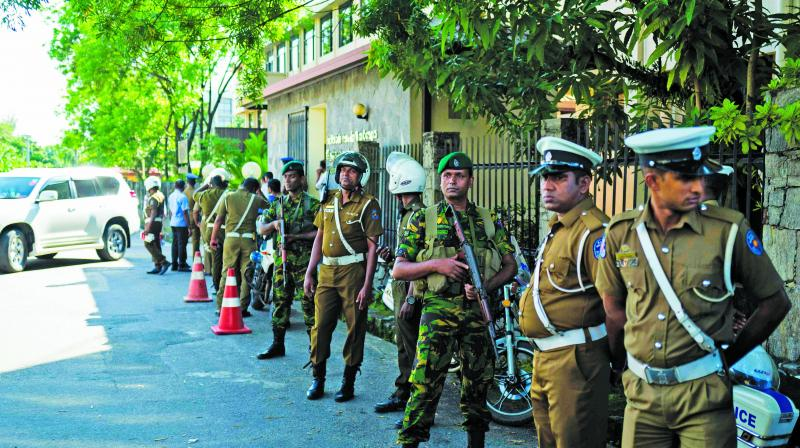 Security personnel stand guard near the election commission office in Colombo on Sunday, before the arrival of President-elect Gotabaya Rajapaksa. (AFP)