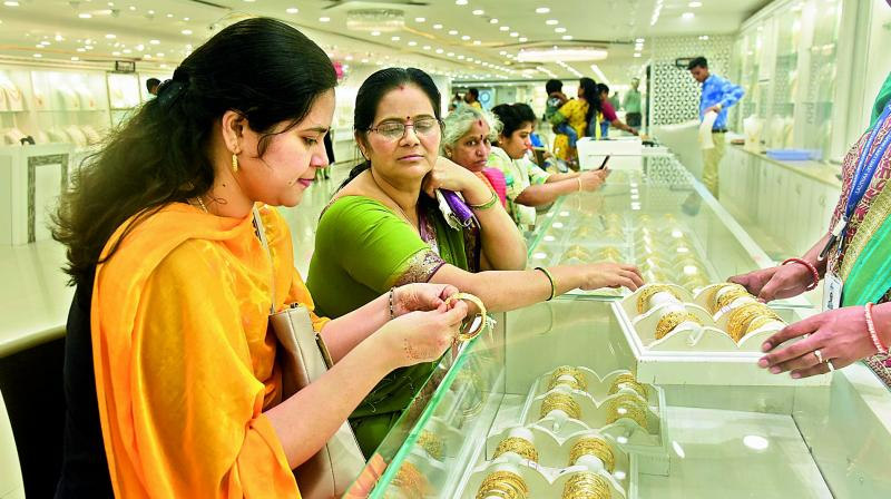 Women purchase gold ahead of Varalakshmi Vratam, which would falls on Friday,