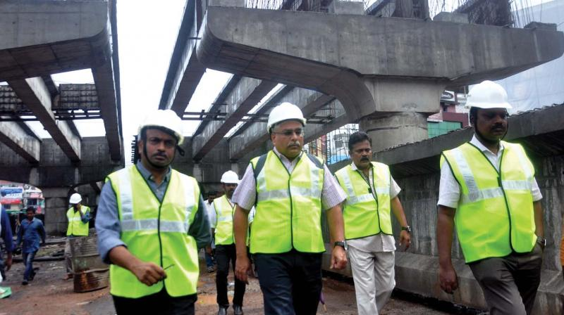 Experts from IIT Madras headed by civil engineering professor B.N. Rao, along with PWD staff, visit Vyttila fly-over work in Kochi on Wednesday (Photo: DC)