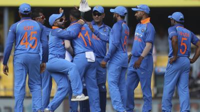 India players celebrate the wicket of Chandrapaul Hemraj. (Photo: AP)