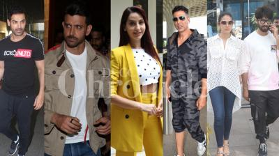 Bollywood stars Akshay Kumar, John Abraham, Shahid Kapoor-Mira Rajput, 'Super 30' actor Hrithik Roshan and others were spotted in the city. (Photos by: Viral Bhayani)