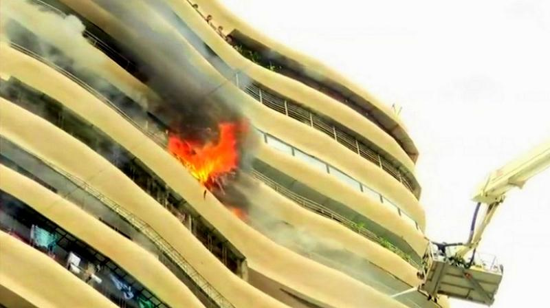 People trapped in the building are being rescued using a crane. (Photo: ANI | Twitter)