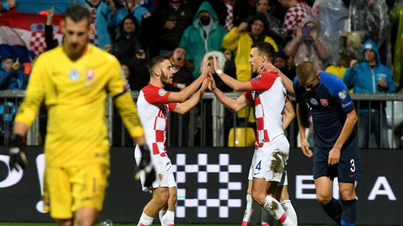 Croatia qualified for Euro 2020 after second-half goals from Nikola Vlasic, Bruno Petkovic and Ivan Perisic inspired a comeback 3-1 home win over Slovakia in a pulsating Group E qualifier on Saturday. (Photo:AFP)