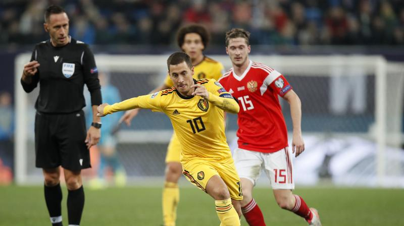 Belgium secured top spot in Euro 2020 qualifying Group I and stretched their perfect record to nine wins after two goals from Eden Hazard and one by his brother Thorgan inspired them to a sparkling 4-1 win in Russia on Saturday. (Photo:AP)