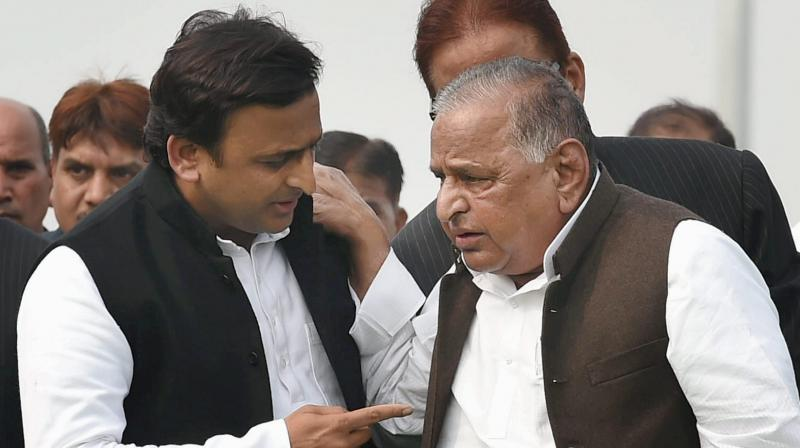 Samajwadi party chief Akhilesh Yadav on Thursday met his father, Mulayam Singh Yadav, with whom he has been fighting a bitter battle, and invited him to a party meet to be held on October 5. (Photo: File   PTI)