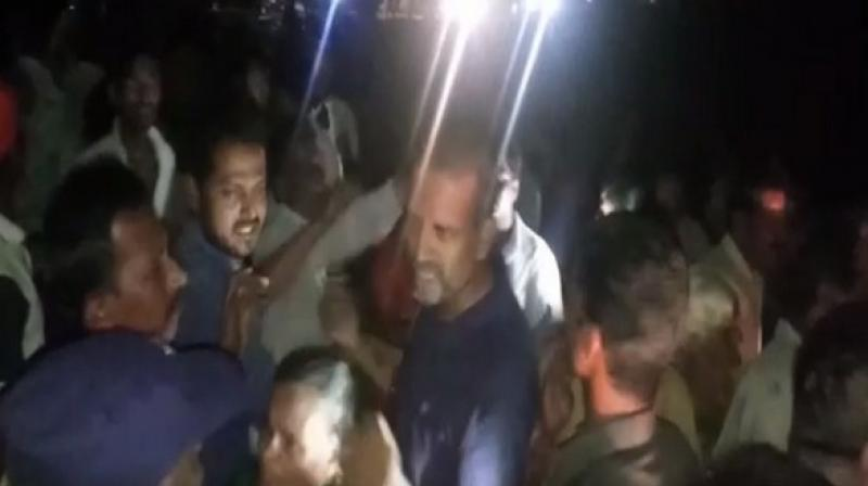 Women tried to attack Mohit Reddy with broom sticks. He sat at the entrance of the village to stage a protest. (Photo: ANI)