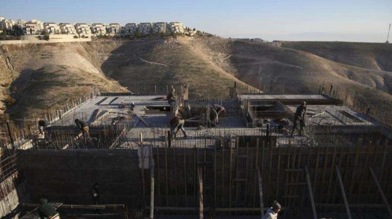 Palestinian laborers work at a construction site in the Israeli settlement of Maale Adumim, near Jerusalem. (Photo: AP)