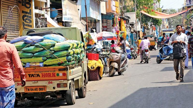 Unauthorised parking on the streets of Mylapore wreak havoc on pedestrians and road users. (Photo: DC)