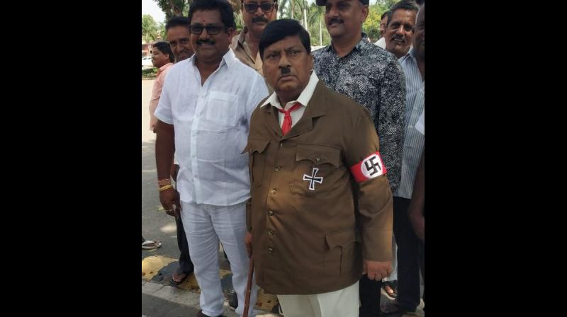 TDP MP Naramalli Sivaprasad - donning a Nazi uniform, toothbrush moustache and a stick in hand - enacted Adolf Hitler while urging his fellow party members to take a stand against the Centre. (Photo: Twitter | ANI)