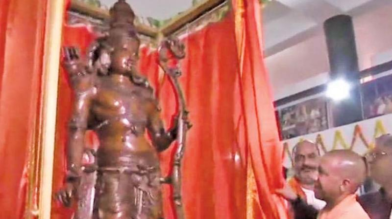 UP chief minister Yogi Adityanath unveils a 7-ft-tall rosewood Lord Ram idol in Ayodhya on Friday. (Photo:  PTI