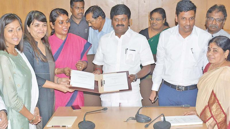 Health minster C.Vijayabaskar receives the agreement copy from World Bank officials at Chennai on Friday. (Photo: DC)